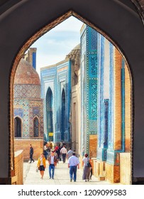 Samarkand, Uzbekistan  13 October 2015: People visit the historical cemetery of Shahi Zinda, in Samarkand, Uzbekistan. Shahi Zinda is an important pilgrimage site for Uzbek muslims.