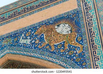 Samarkand, Uzbekistan - Aug 30 2018: Sher-Dor Madrasa at Registan in Samarkand, Uzbekistan. It is part of the Samarkand - Crossroad of Cultures World Heritage Site.