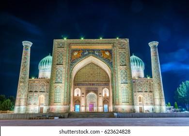 SAMARKAND, UZBEKISTAN - AUGUST 28: Illuminated Sher-Dor Madrasah at night, Samarkand Registan landmark, Uzbekistan. August 2016
