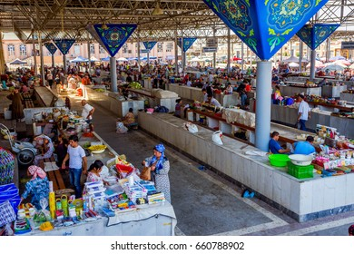 SAMARKAND, UZBEKISTAN - AUGUST 28: Stalls at Siab bazaar, local fruit, vegetable and spices market with people buying and selling. Samarkand, August 2016