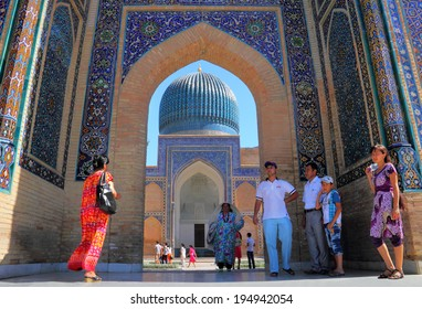 SAMARKAND, UZBEKISTAN - JULY 07: Unidentified uzbek people walking in ancient Bibi-Khanym Mosque on July 07, 2013 in Samarqand, Uzbekistan. It is one of the foremost interesting place in Central Asia
