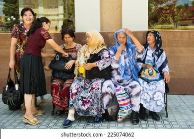 SAMARKAND, UZBEKISTAN - JUNE 10, 2011: Unidentified Uzbek women smile in the street Uzbekistan, Jun 10, 2011.  81% of people in Uzbekistan belong to Uzbek ethnic group