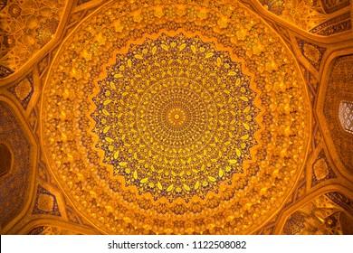 SAMARKAND, UZBEKISTAN - JUNE 12, 2018: Beautiful golden facade of the mosque building in Uzbekistan tourist city of Samarkand ancient Muslim buildings of the XVII century