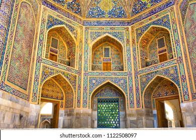 SAMARKAND, UZBEKISTAN - JUNE 12, 2018: Beautiful facade of the building of the Registan mosque in Uzbekistan tourist city of Samarkand ancient Muslim buildings of the XV-XVII centuries