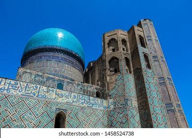 Samarkand, Uzbekistan - May 09, 2019: Blue Sky and Old Roofs of the Bibi Khanym Palace