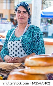 SAMARKAND, UZBEKISTAN - MAY 10, 2019: Woman selling bread at Siab Bazaar in the center of Samarkand, Uzbekistan