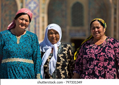 SAMARKAND, UZBEKISTAN - MAY 20, 2017: Uzbek ladies in local dress, in the Registan Square, look at me, in Samarkand, Uzbekistan.