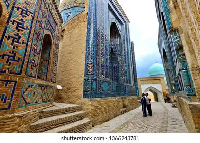 SAMARKAND, UZBEKISTAN - MAY 20, 2018: People visit the historical cemetery of Shahi Zinda, in Samarkand, Uzbekistan