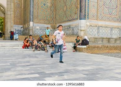 Samarkand, Uzbekistan. May 2019. Residents of Samarkand near the entrance to the mosque Bibi Khanum