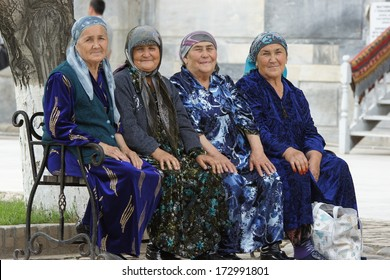 SAMARKAND, UZBEKISTAN - MAY 27: Four old woman sitting on a bench on May 27, 2012 in Samarkand, Uzbekistan. The image was taken on the registan square.
