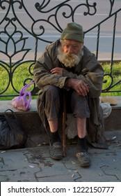 Samarkand / Uzbekistan, Oct 11, 2018: A beggar elderly man sits on the ground