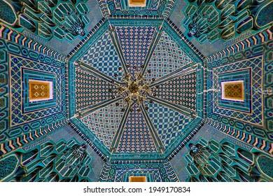 SAMARKAND, UZBEKISTAN - OCTOBER 12, 2018: Tiled ceiling of the mausoleum building in the historical cemetery of Shahi Zinda in Samarkand, Uzbekistan