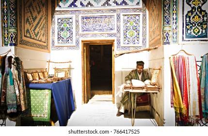 SAMARKAND, UZBEKISTAN - October, 2014: Uzbek man in his workshop producing souvenirs for sale at Registan square, Samarkand, Uzbekistan