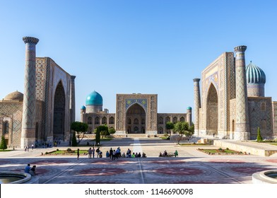 Samarkand, Uzbekistan - September 19, 2013: Sunset on Registan square. The three madrasahs of the Registan are : the Ulugh Beg Madrasah, the Tilya-Kori Madrasah and the Sher-Dor Madrasah.