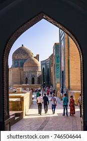 SAMARKAND, UZBEKISTAN - SEPTEMBER, 20, 2013: Unidentified people wandering in ancient complex of buildings of Shah-i-Zinda - Samarkand, Uzbekistan