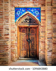 SAMARKAND/UZBEKISTAN - JULY 07: Door with floral decoration in Mausoleum Gur Emir (Amir Timur tomb) on July 07, 2017 in Samarqand, Uzbekistan. It is one of the most interesting place in Central Asia