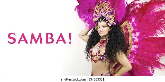 Samba - cheerful woman portrait wearing traditional pink costume