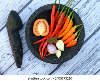Sambal terasi. Chili, cayenne pepper, shrimp paste, tomatoes, shallots, garlic on stone ware. Sambal is a complementary food in Indonesia. Indonesian likes chili sauce. Indonesian food.