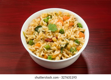 Sambar Rice - Tasty and popular south indian recipe served in a terracotta or ceramic bowl, selective focus