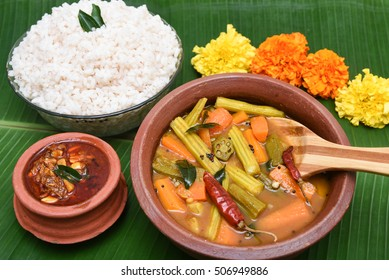 Sambar South Indian curry/ dish in earthen bowl Kerala, India. lentil/ dal, vegetable stew Tamil cuisine Indian spices. side dish of rice/ coconut, Idly, dosa, traditional Onam sadhya, Vishu, Pongal