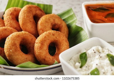 Sambar Vada also known as Medu Vada, a popular South Indian food. served with white coconut chutney and sambar.