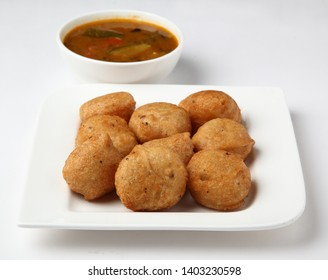 Sambar Vada also known as Medu Vada, a popular South Indian food. served with white coconut chutney and sambar
