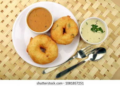 Sambar vada a popular south Indian food on Bamboo mat background, Top view
