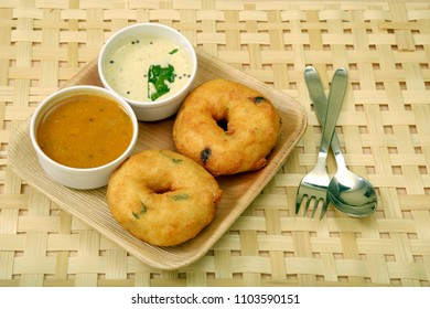 Sambar vada a popular south Indian food with sambar and coconut chutney on wooden background