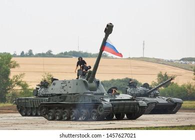 SAMBEK, ROSTOV REGION, RUSSIA, JUNE 28, 2019: International military technical forum ARMY-2019. Crew of tank get inside the self-propelled howitzer 2S3M «Akatsiya»