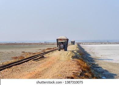 Sambhar, India - February 02, 2019: Tractors loaded with solt on the road from Sambhar solt lake. Rajasthan