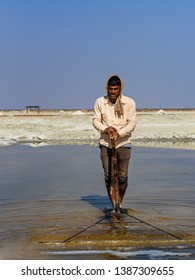 Sambhar, India - February 03, 2019: Indian man mining salt on Sambhar Salt Lake. Rajasthan