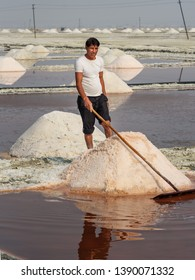 Sambhar, India - February 04, 2019: Indian man mining salt on Sambhar Salt Lake. Rajasthan