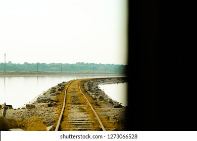Sambhar, Rajasthan - December 14, 2018: A narrow passage going between two salt water parts, taking a curve and ends into the black bar.