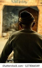 Sambhar, Rajasthan - December 14, 2018: The old man is making tea at his stall.