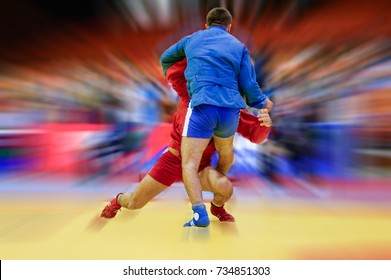Sambo fighter attacking his opponent with leg technique