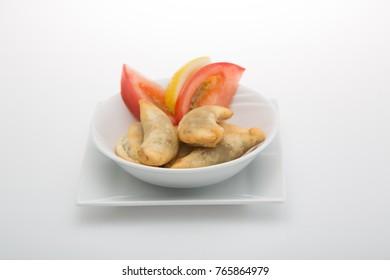 Sambousek is an appetizer in Arabic cuisine