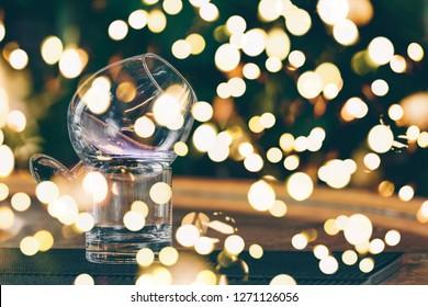 Sambuca cocktail at the bar stand. Luxury vacation concept. Horizontal. Bold festive bokeh