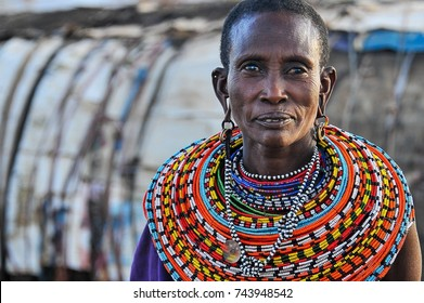 Samburu, Kenya - August 2014: Portrait of an African woman wearing elaborate beaded collar & earrings, denoting marital status