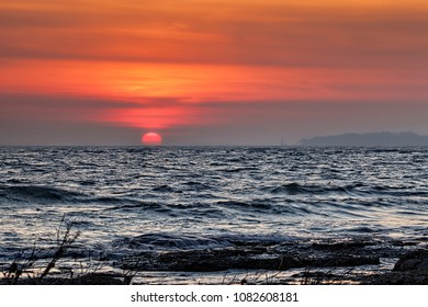 """Same night as the December """"Super Moon"""", the sunset was across Lake Erie in virtually the exact opposite direction as the moonrise, which was to start 34 minutes after this image was taken."""