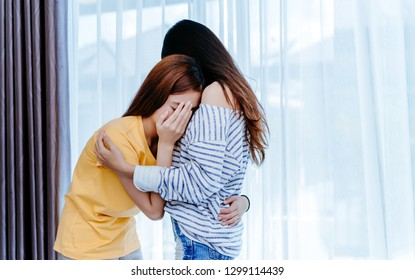 Same sex asian lesbian couple lover consoling girlfriend her cry the bedroom at morning sad emotion, LGBT sexuality female living together at home,Copy space.