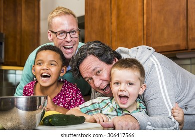 Same sex couple and kids having fun at meal time