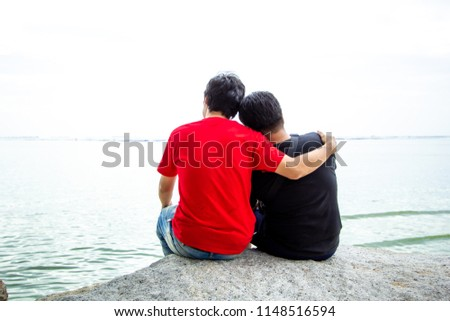 Same Sex Couples Are Passionately At The Beach Gay