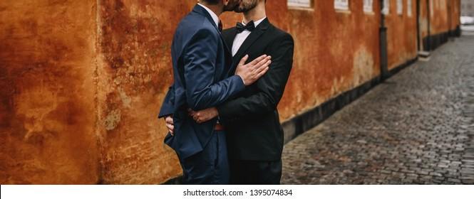 Same sex gay couple walking around the city.