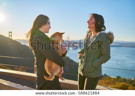 Lesbian enjoying dogs