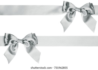 Same silver gift bows on the ribbon in different locations isolated on white