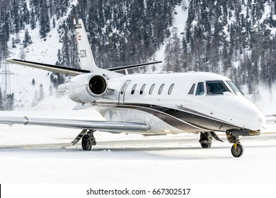 SAMEDAN - FEBRUARY 10: A private jet (Bizjet) Cessna Citation 560XL Reg. OE-GZK  bring passenger for FIS Alpine World Ski Championships and White Turf of St Moritz, Switzerland on February 10, 2017