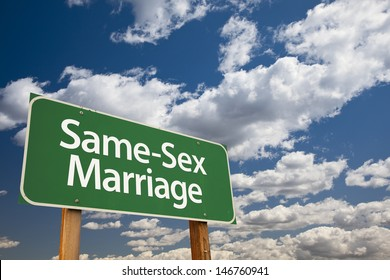Same-Sex Marriage Green Road Sign Over Dramatic Blue Sky and Clouds.