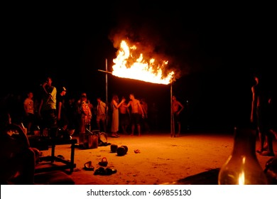 Samet Island, Thailand - December 31th, 2015; blur fire limbo on the beach of Samet Island at night during a New years party