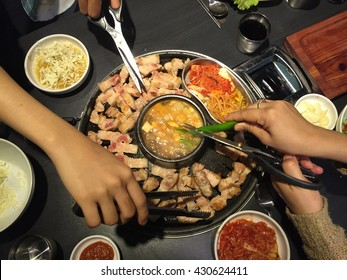 """Samgyeopsal : pork strips sizzling on a grill "" Korean BBQ"