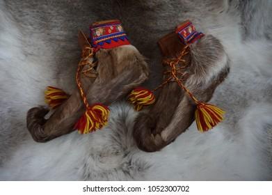 Sami handcraft reindeer skin shoes